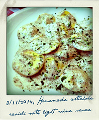 Homemade artichoke ravioli with light wine sauce