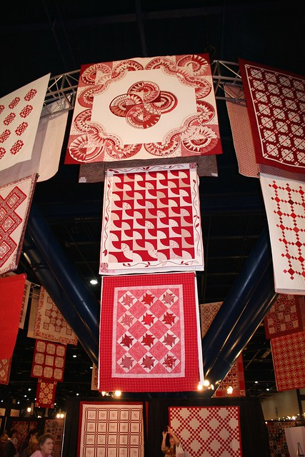 Impressive display of red and white quilts