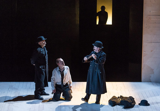 Michael Bennett as Guard Franz, Johnny Herford as Josef K and Nicholas Folwell as Guard Willem in Philip Glass's The Trial © Photo by ROH.Clive Barda