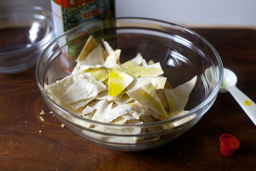 tossing pita with oil to roast into chips