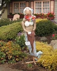 dress(0.0), autumn(0.0), art(1.0), agriculture(1.0), flower(1.0), garden(1.0), tree(1.0), scarecrow(1.0), spring(1.0), statue(1.0),