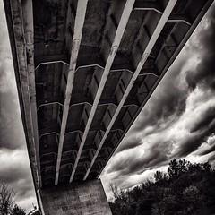 Under the #train #bridge! #blackandwhite #blackandwhitephotography #landscape #clouds #sky @enrlt01