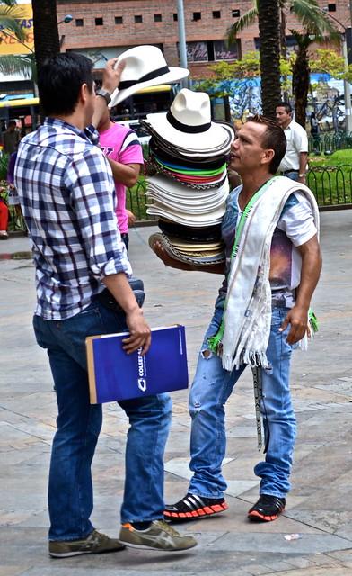 hat seller, botero plaza, medellin, colombia