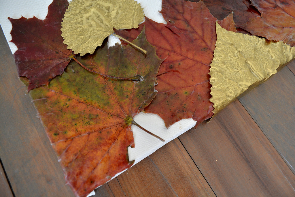 Natural colored and gilded leaves make beautiful fall artwork for your home! // Lovely Wren