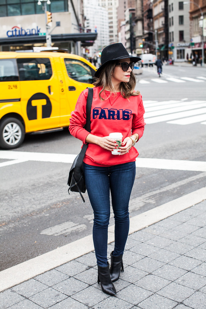 red paris sweatshirt otte nyc black hat fall outfit coach dakota bag ag skinny jeans casual outfit fringe boots sam edelman boots nordstrom sunglasses kate spade red lipstick new york fashion blogger corporate catwalk