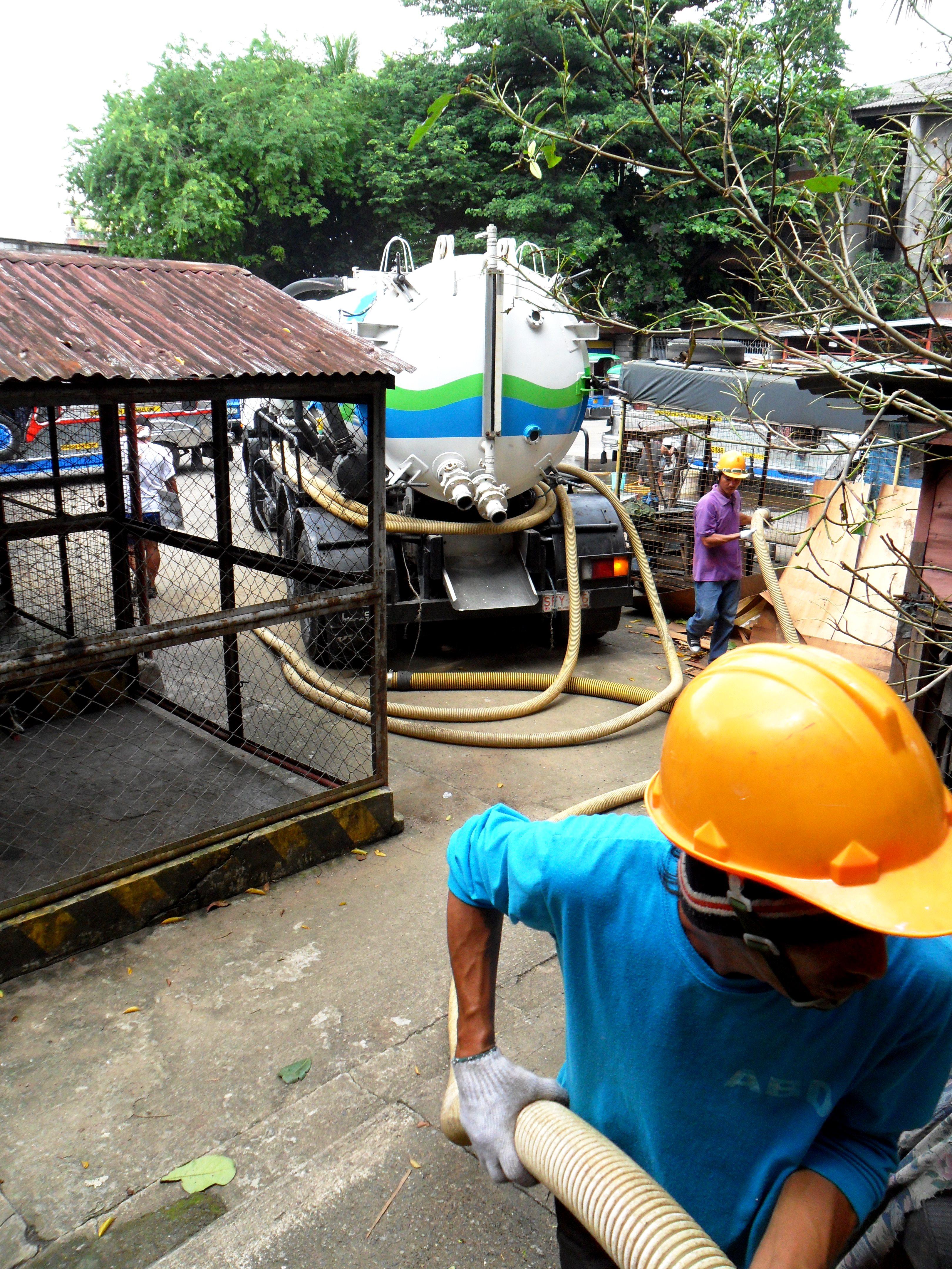 Septic tank desludgers at work in Metro Manila, Philippines. Photo: Julian Doczi/ODI