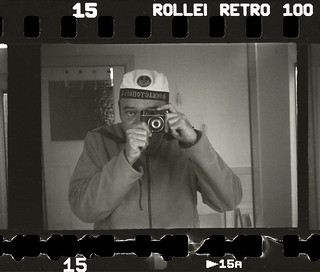 reflected self-portrait with Vesna camera and Russian naval hat