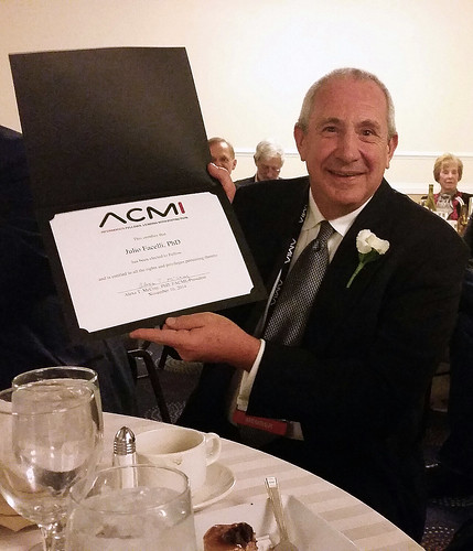 Dr. Facelli with his induction award