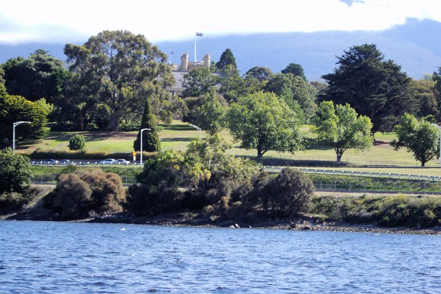 Hobart. A partial view of the Gothic Government House of Tasmania from the Derwent River.