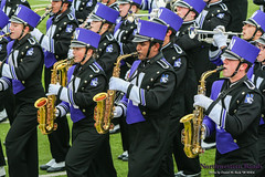 Company Front ::  	   The Northwestern University 'Wildcat' Marching Band rehearses outside Ryan Field before Northwestern Football hosts Wisconsin on October 4, 2014.  Photo by Daniel M. Reck '08 MSEd.