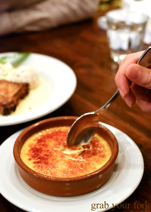 Cracking the toffee on the creme brulee at Bistro Papillon, Sydney