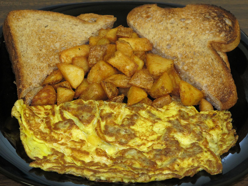 Sausage and cheddar omelet with home fries and wheat toast