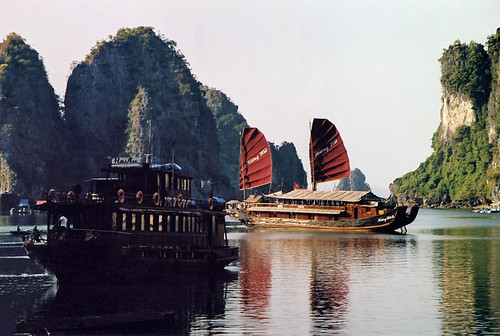 A Junk with Red Sails in Halong Bay in Vietnam