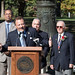 State Representatives Tony D'Amelio addressees the crowd during the 2016 Italian Mayor of the Day ceremony outside Waterbury City Hall on Friday, October 7.  Standing in back, from left - State Senator Joan Hartley, State Representatives Larry Butler and Jeff Berger, Honorary Italian Mayor of the Day John Sarlo, and State Rep. Geraldo Reyes Jr.,