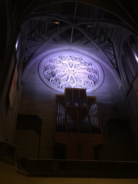 Rose Window inside Grace Cathedral at night