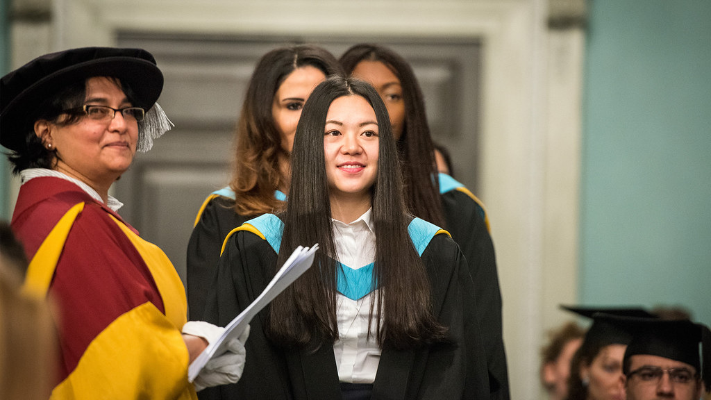 A student at a graduation award ceremony