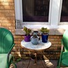 My favorite porch sittin' spot. #home #succulents #gnomes! #books!