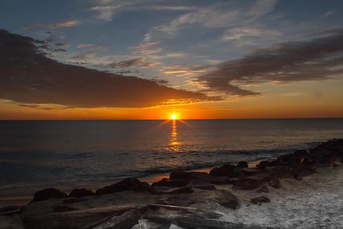ocean sky sun fall beach water clouds sunrise newjersey rocks waves jetty nj atlantic og monmouthcounty stockphoto bsp 2014 monmouthbeach