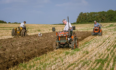 Three compact tractors ploughing at Longstock in Hampshire