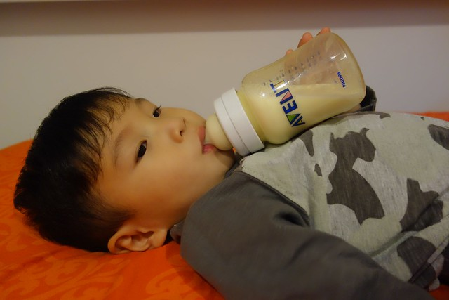 Jerome quietly drinking his milk at bedtime with his Philips Avent milk bottles.