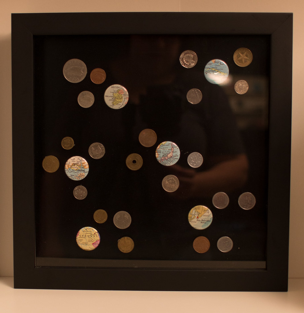 Shadowbox displaying foreign coins from travels