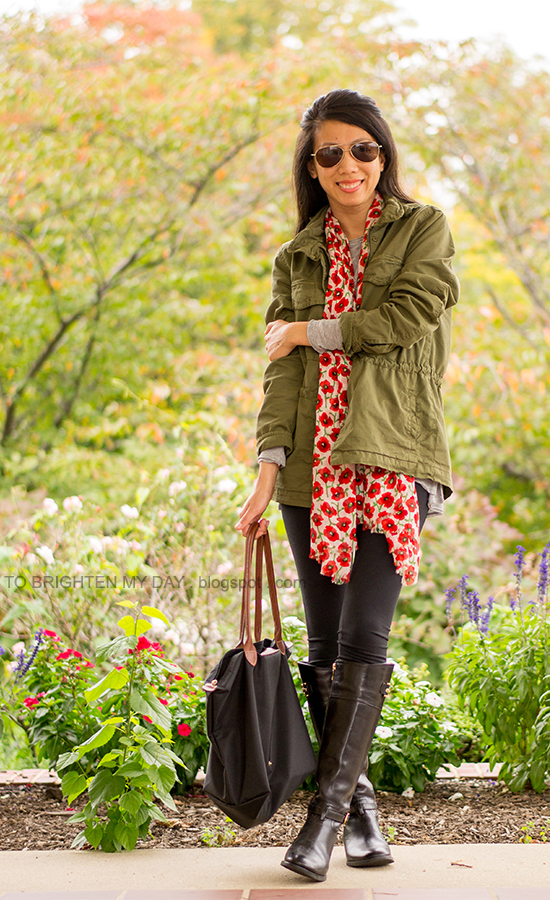 green military jacket, gray tee, poppy printed scarf, black riding boots