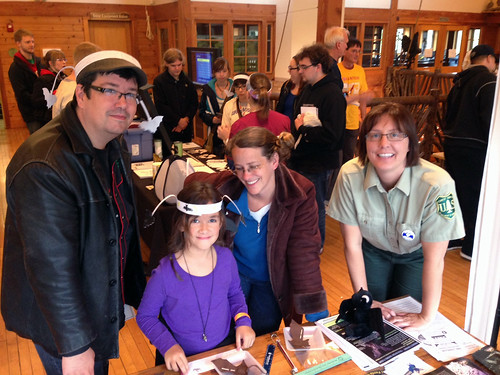 A family learns more about how bats create economic and ecosystem benefits from Cynthia Sandeno, acting regional wildlife biologist for the Forest Service's Eastern Region during the Wisconsin Bat Festival at the Urban Ecology Center in Milwaukee. (U.S. Forest Service/Cassie Cibik)