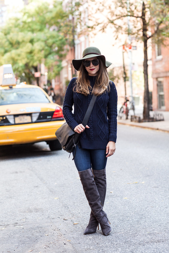 banana republic cable sweater blue navy sweater ag adriano goldschmied ultra skinny leggings karen walker harvest sunglasses coach crossbody bag black coach purse army green felt hat over the knee grey joie olivia boots lime crime red velvet lipstick