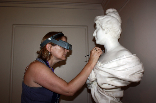 Conservator Madeline Graham works on the bust of Dame Nellie Melba, the Royal Opera House © ROH 2016