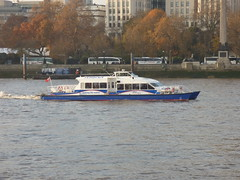River Thames from the South Bank in London - boat - mbna - Thames clippers - Storm Clipper