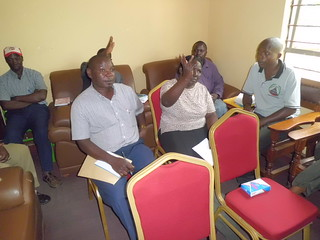 Participants discuss pig value chain, Kabonera, Uganda