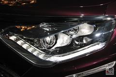 grille(0.0), automobile(1.0), automotive exterior(1.0), vehicle(1.0), automotive lighting(1.0), automotive design(1.0), light(1.0), auto show(1.0), bumper(1.0), headlamp(1.0), land vehicle(1.0),