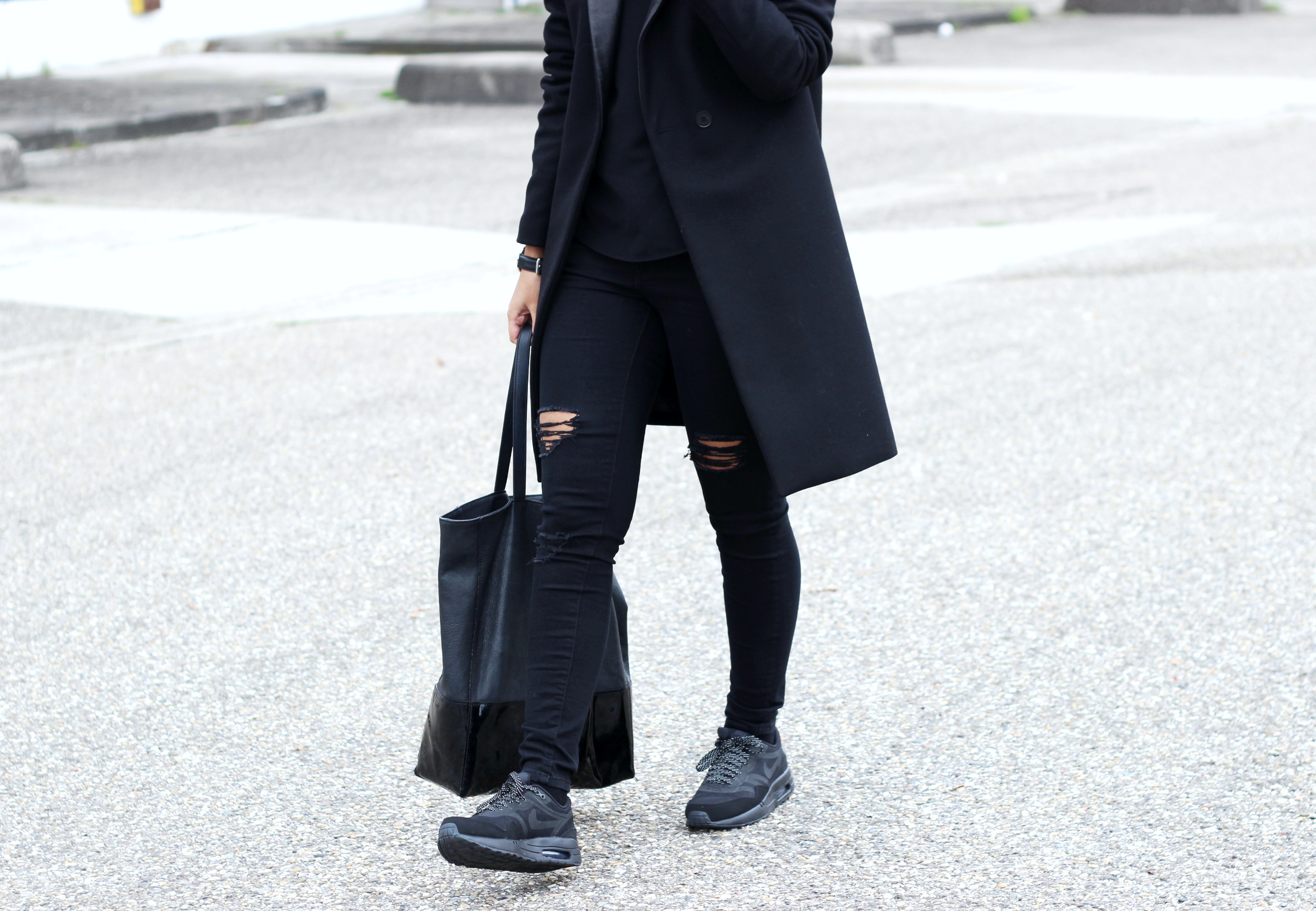 Black on black street style sneakers trend