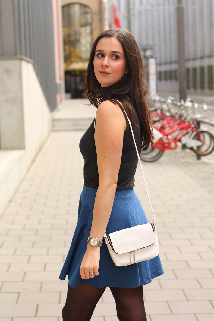 turtle neck denim skater skirt cross body bag