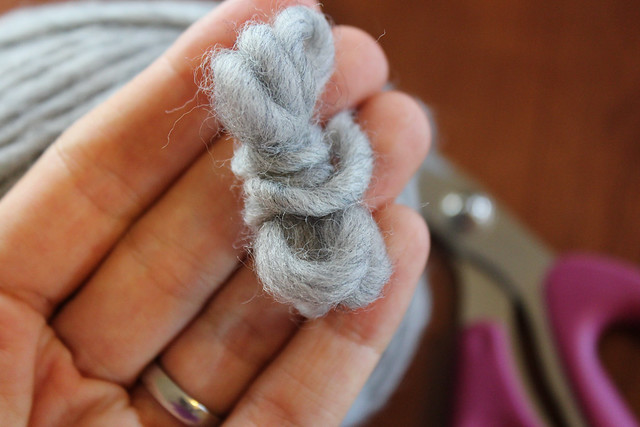 Wrap the yarn around itself tightly.