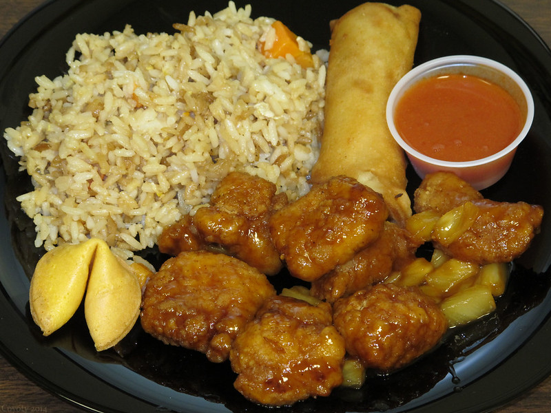 Teriyaki chicken with pineapple, rice, eggroll, hot sauce, and fortune cookie