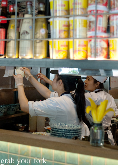 Chefs checking dockets in the kitchen at Mama's Buoi, Surry Hills