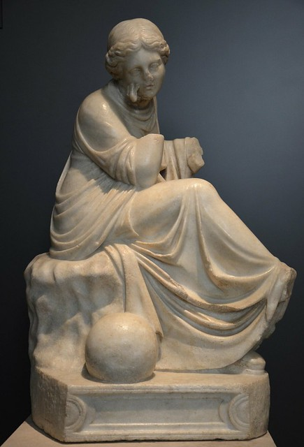Statue of Urania, muse of Astronomy, in a pensive pose with the celestial globe at her feet, 1st century BC, National Archaeological Museum of Spain, Madrid