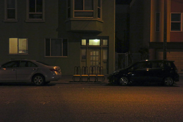 Chairs in a row on 14th ave and Lincoln, night; The Sunset, San Francisco (2014)