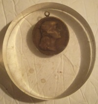 Medal encased in Lucite