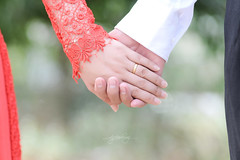 groom(0.0), petal(0.0), hand(1.0), flower(1.0), finger(1.0), close-up(1.0), romance(1.0), interaction(1.0), holding hands(1.0),