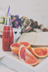 Breakfast in bed with fresh juice and grapefruit