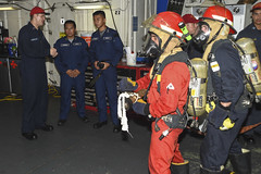 Officers from the Philippine Navy look on as Sailors aboard USS Peleliu (LHA 5) participate in a fire fighting drill. (U.S. Navy/MC1 Joshua Hammond)