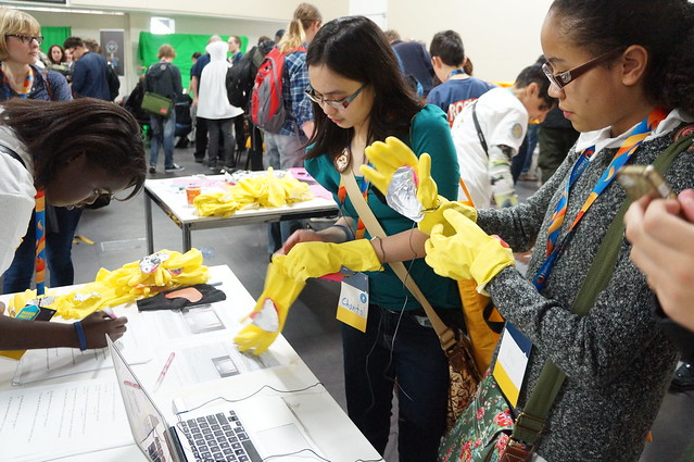 An image of young people hacking wearable sensors on gloves