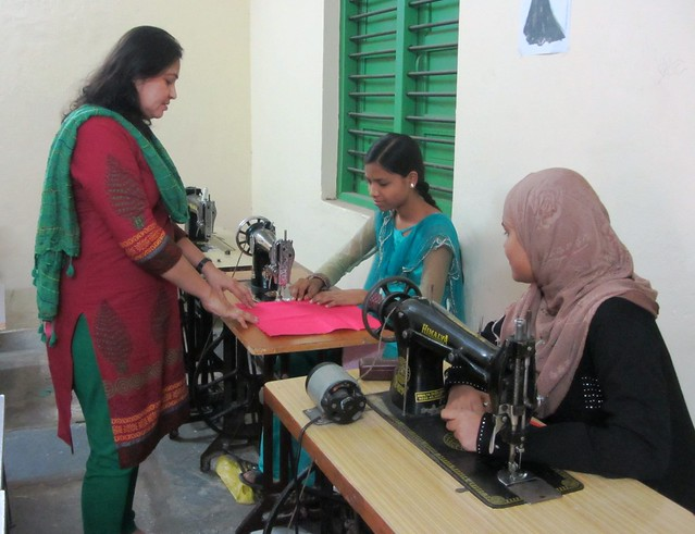 "Rubina interacts with Firdaus Anjum (right), enrolled in one-year fashion designing course along with Neha Anjum, a BA student. ""I came to know about the course through pamphlets and some girls from my area too had done this course,"" Neha says."