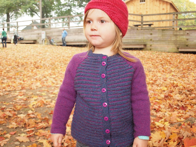 looking contemplative in elle melle and her new red hat