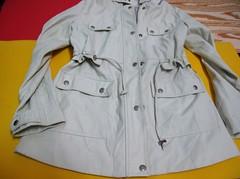 clothing(1.0), yellow(1.0), sleeve(1.0), outerwear(1.0), jacket(1.0), coat(1.0), trench coat(1.0), shirt(1.0),