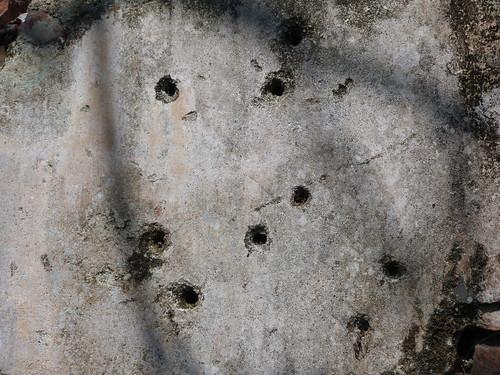 Disparos de la guerra en una pared de Hué (Vietnam)