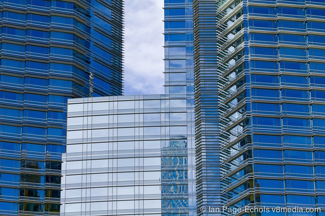 Angular glass buildings with reflections