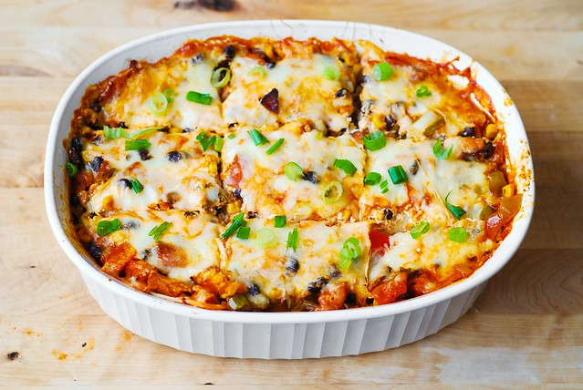 Mexican enchilada casserole sliced in the baking dish
